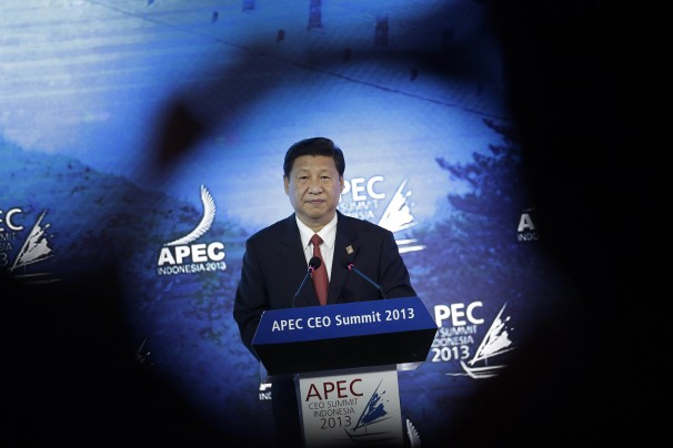 China's Xi takes advantage of Obama absence from Asia-Pacific trade summit